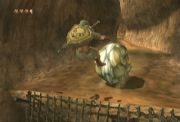 Goron sends Link flying.